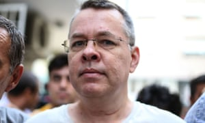 Andrew Brunson is escorted by Turkish officers on 25 July in Izmir, Turkey.