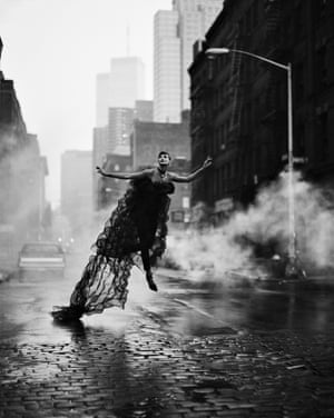 Linda Evangelista 'flying' through a New York street in a long, trailing black gown
