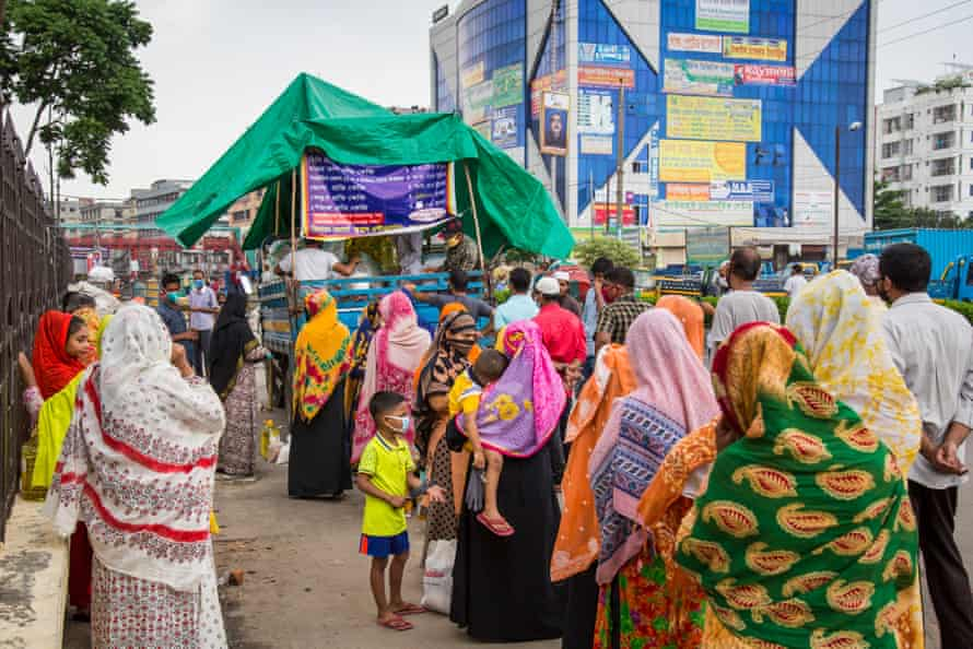 A long queue of shoppers before a mobile truck shop