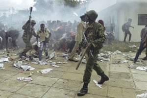 Police intervene during a stampede outside the Kasarani stadium in Nairobi as supporters of Kenya's president, Uhuru Kenyatta, try to get into the venue to attend his inauguration ceremony.