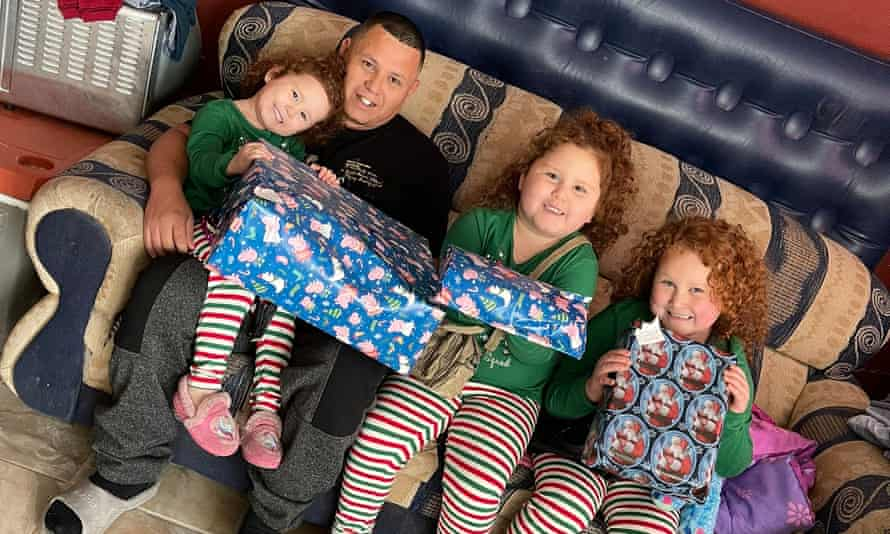Juan Garcia with his three daughters.