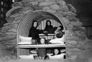 Londoners in a sandbag-protected Anderson shelter during the second world war.