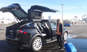 Stephanie Theobald gets ready to 'board' the Tesla Model X for the drive to Vegas.