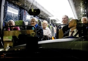 Evacuated residents of a care home sit inside a bus as they are taken to a reception location, in the municipality of Valkenburg aan de Geul, the Netherlands
