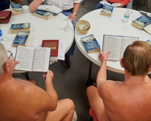 Phillip Mangus, a retired farmer from Indiana, and George Lane, a lifelong nudist from Indianapolis, read scripture during a small service at the Garden of Eden church on 17 November 2019 at the Lake Como Co-Op nudist community in Lutz, Florida.