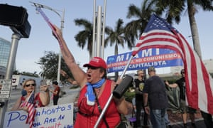 A supporter of Donald Trump makes their voice heard outside the Adrienne Arsht Center in Miami