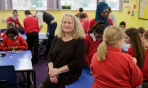 Headteacher Sue Vermes in a busy classroom at Rose Hill primary school in Oxford.