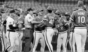 Tom House, middle, and umpire Don Denkinger restrain Texas Rangers pitcher Dave Stewart in Anaheim in June 1985.
