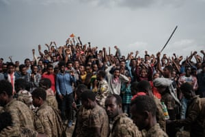 People react as captive Ethiopian soldiers walk towards the rehabilitation centre in Mekelle, the capital of Tigray region.