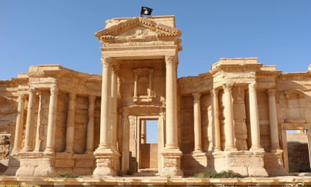 An Islamic State flag flies atop Roman ruins at the ancient city of Palmyra