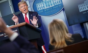 Donald Trump and reporters at the daily coronavirus briefing at the White House on 13 April.