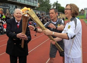 Sir Roger Bannister passes the Olympic flame to Torchbearer 001 Nicola Byrom on the track at Iffley Road Stadium at the start of day 53 of the London 2012 Olympic Torch Relay.