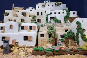 Lynn Nolan's nativity cake re-created the city of Bethlehem and will be auctioned for charity, with the profits going to a local primary school.