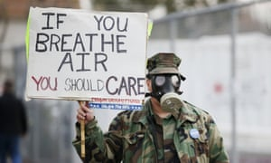 Brian Seligman holds a sign to protest a gas leak in the Porter Ranch area of Los Angeles before a meeting of the California air quality management district in Granada Hills on Saturday.