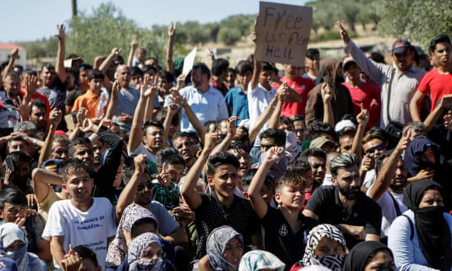Refugees and migrants at a demonstration against living conditions at Moria camp on Lesbos, Greece