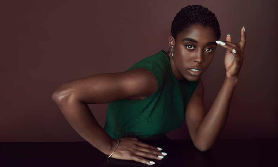 Lashana Lynch wears green dress  by edelinelee.com and earrings by farisfaris.com.