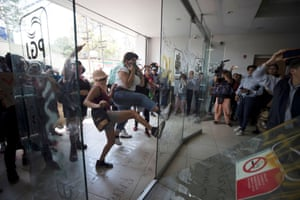 Mexico City, Mexico: Demonstrators kick a glass door outside Mexico City's attorney general's office after local media reported that a teenage girl had been raped by four police officers