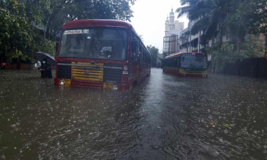 Buses are stranded on a waterlogged road in Mumbai