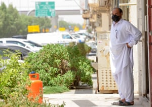 A mask-clad man stands outside his workplace in the Saudi capital Riyadh, 6 June 2020.