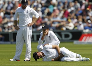 Joe Root can't help himsels as his captain Alastair Cook lies hurt after being hit where it hurts