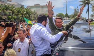 Brazilian far-right presidential candidate Jair Bolsonaro greets supporters after voting, in Rio de Janeiro, Brazil.
