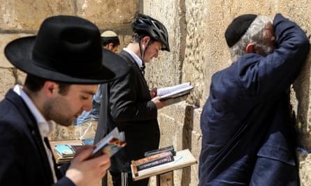 Jews praying by the Western Wall.