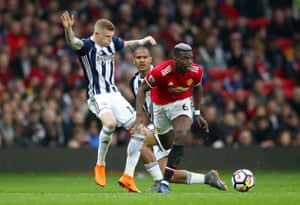 McClean goes over after a push from Pogba.