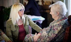 A young woman talks to an older woman