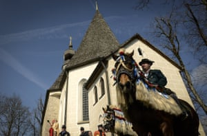Participants ride around the local chapel