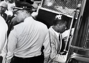 Lewis being arrested in Jackson, Mississippi on 24 May 1961. He and 26 other Freedom Riders were arrested that day.