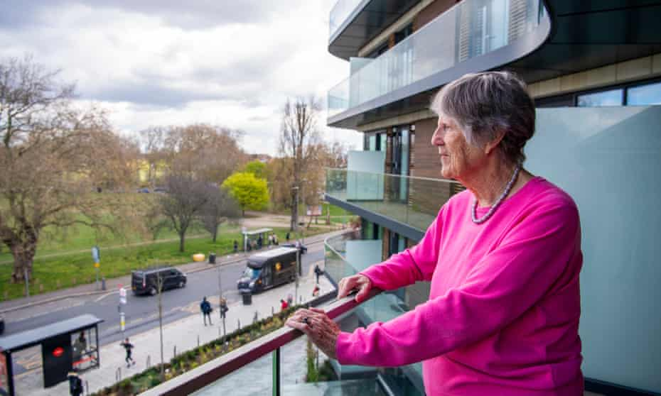 Lady Gadsden, a resident at Audley Nightingale Place retirement village in Clapham, looks out from her balcony.