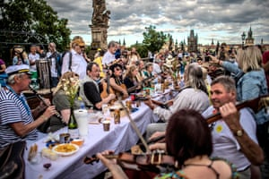 Prague, Czech RepublicDiners sit at a table measuring 515 meters (1,690 feet) in length and spanning the entirety of the iconic Charles Bridge. The party came after the easing of restrictions imposed in a bid to slow down the spread of COVID-19.