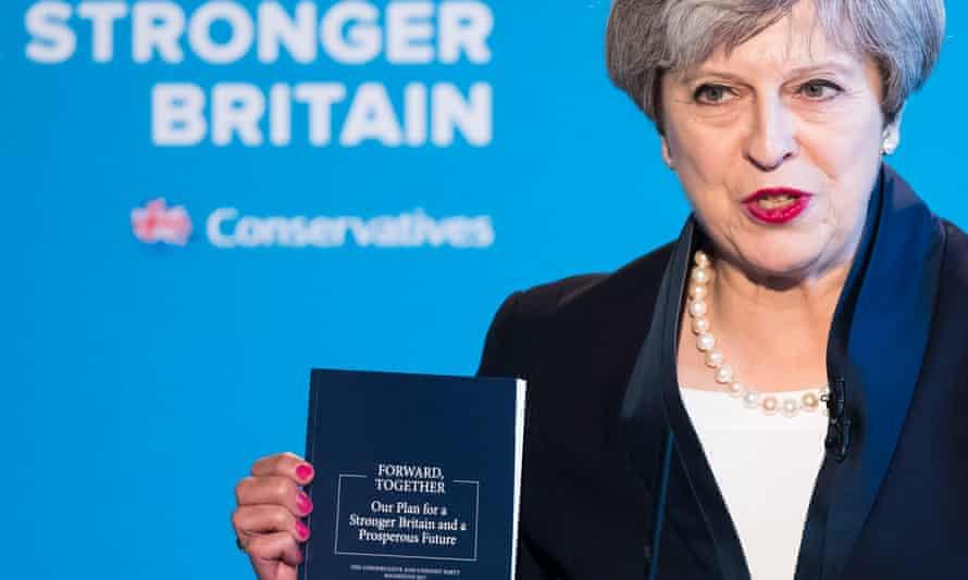 Theresa May with manifesto