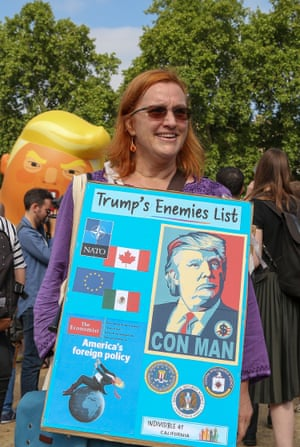 A protester shares her thoughts on Trump's enemies, in Parliament Square
