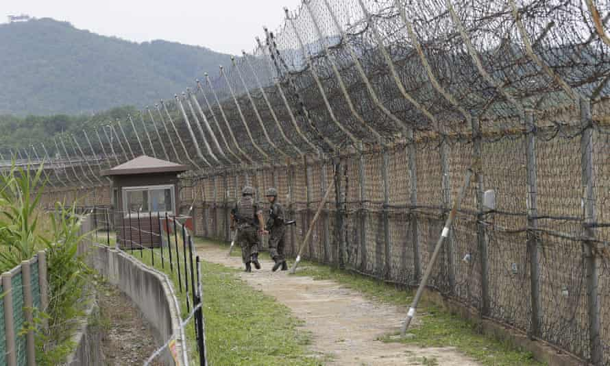 South Korean army soldiers patrol in the demilitarized zone where a suspected defector from the North was detained.