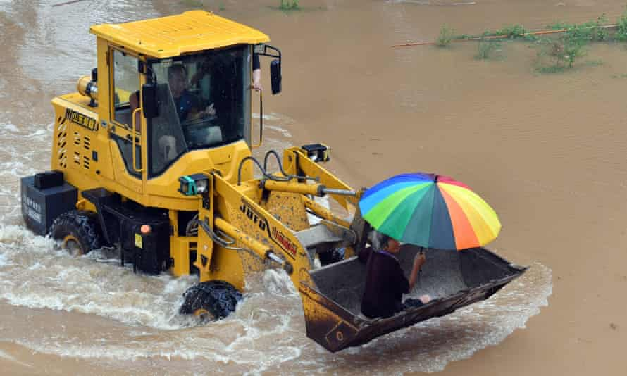 China Henan Xinxiang Rainfall Rescue - 22 Jul 2021Mandatory Credit: Photo by Xinhua/REX/Shutterstock (12226221b) Staff members drive a shovel loader to help a local resident to evacuate from Huangzhuang Village in Weihui of Xinxiang, central China's Henan Province, July 22, 2021. Over 500 local residents have so far been evacuated from Xinxiang's Huangzhuang Village as torrential rain hit a number of cities in Henan Province including Xinxiang recently. China Henan Xinxiang Rainfall Rescue - 22 Jul 2021