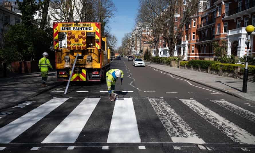 Iconic ... a maintenance team repaints the crossing on 24 March.