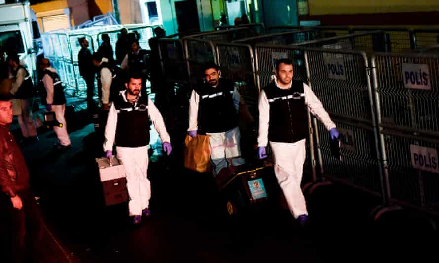 Turkish forensics police officers leave after searching the Saudi consulate in Istanbul on 18 October 2018