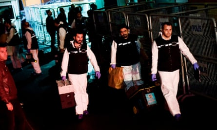 Turkish police officers leave after searching the Saudi consulate in Istanbul on 18 October.