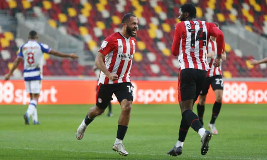 Bryan Mbeumo celebrates the first of his two goals for Brentford with teammates as the Reading recriminations go on in the background