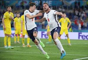 England's Jordan Henderson celebrates scoring their fourth goal with John Stones.