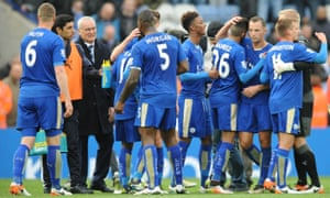 Leicester's manager Claudio Ranieri celebrates with players at the end of the Premier League game with Swansea City on 24 April.