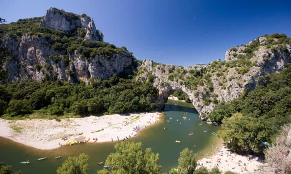 Karst of many … canoeing on the Ardèche gorge.