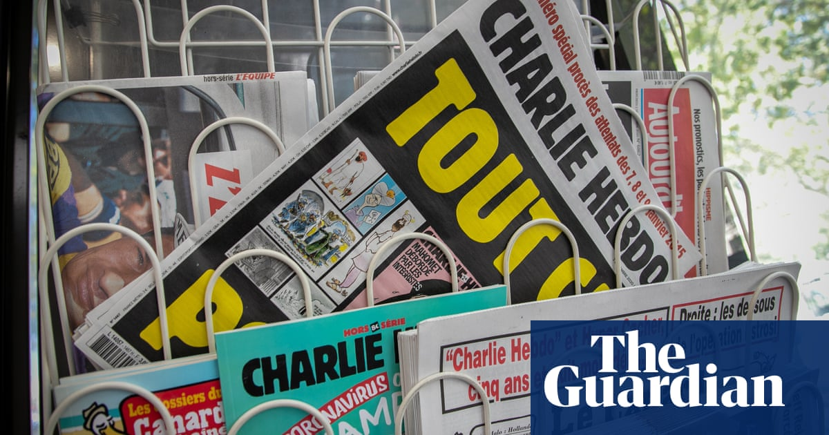 French journalists unite to back Charlie Hebdo after death threats