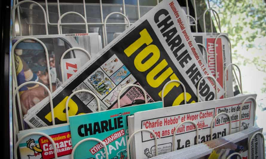 Charlie Hebdo magazine for sale in a newsagent