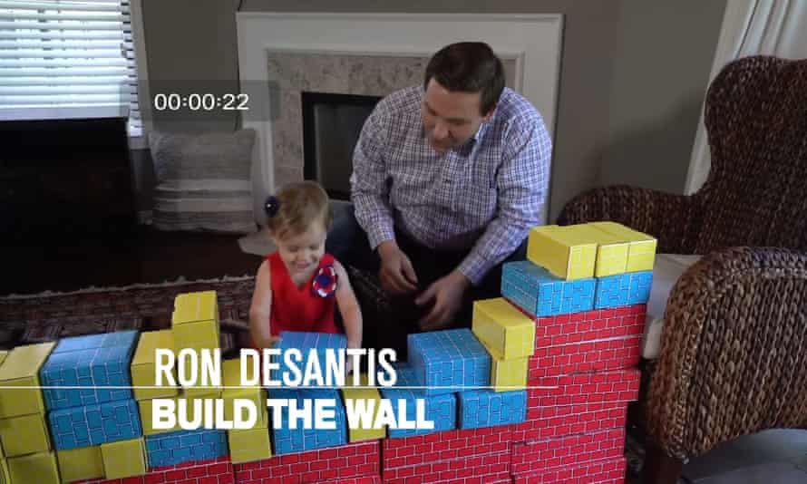A campaign ad for Ron DeSantis features him building a border wall of toy blocks with his toddler daughter.