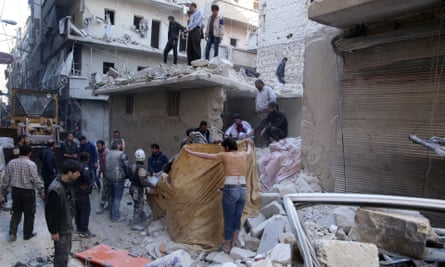 Civilians try to rescue people from a building after Russian airstrikes on opposition-controlled al-Salihiya district in Aleppo, 11 March.