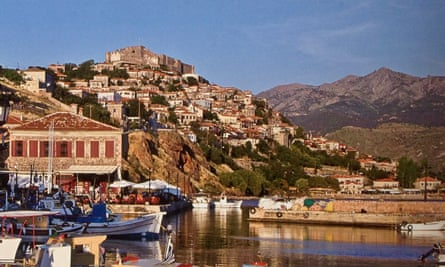 A view from the Molyvos harbour with the old castle at the top.