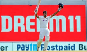 Ravichandran Ashwin of India celebrates after scoring a hundred.