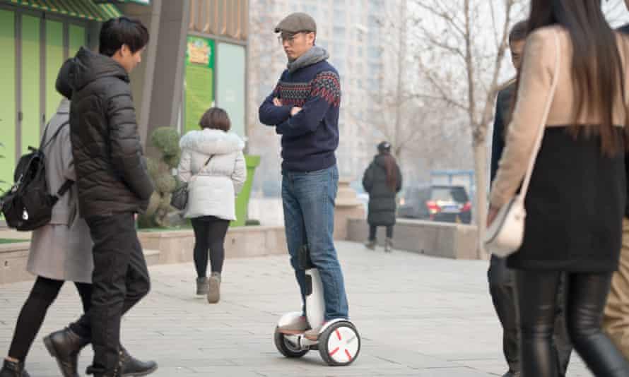 man riding a ninebot segway